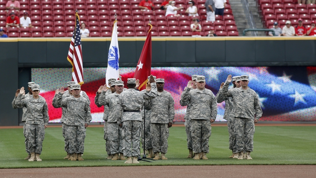 Sep 11, 2013; Cincinnati, OH, USA; U.S. Army soldiers are sworn in during pre-game ceremonies prior to a game with the Chicago Cubs and the Cincinnati Reds at Great American Ball Park. Mandatory Credit: David Kohl-USA TODAY Sports