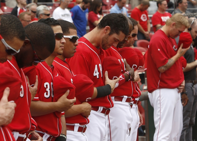 Sep 11, 2013; Cincinnati, OH, USA; Cincinnati Reds players stand during a moment of silence in honor of Patriots Day prior to a game with the Chicago Cubs at Great American Ball Park. Mandatory Credit: David Kohl-USA TODAY Sports
