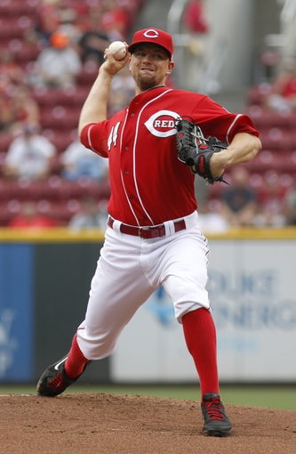 Sep 11, 2013; Cincinnati, OH, USA; Cincinnati Reds starting pitcher Mike Leake throws against the Chicago Cubs in the first inning at Great American Ball Park. Mandatory Credit: David Kohl-USA TODAY Sports