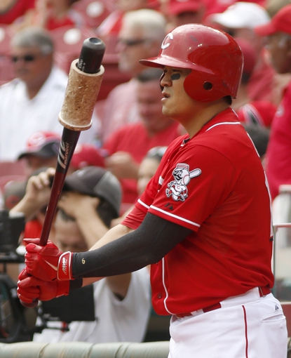 Sep 11, 2013; Cincinnati, OH, USA; Cincinnati Reds center fielder Shin-Soo Choo prepares on deck during a game against the Chicago Cubs at Great American Ball Park. Mandatory Credit: David Kohl-USA TODAY Sports