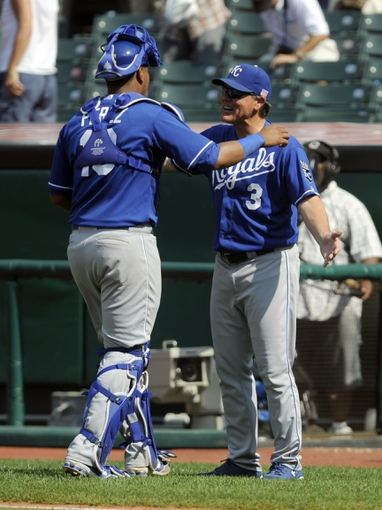 Sep 11, 2013; Cleveland, OH, USA; Kansas City Royals catcher Salvador Perez (13) celebrates with manager Ned Yost after the Royals beat the Cleveland Indians 6-2 at Progressive Field. Mandatory Credit: Ken Blaze-USA TODAY Sports
