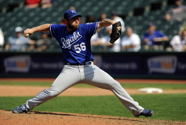 Sep 11, 2013; Cleveland, OH, USA; Kansas City Royals pitcher Greg Holland (56) pitches against the Cleveland Indians during the ninth inning at Progressive Field. Mandatory Credit: Ken Blaze-USA TODAY Sports