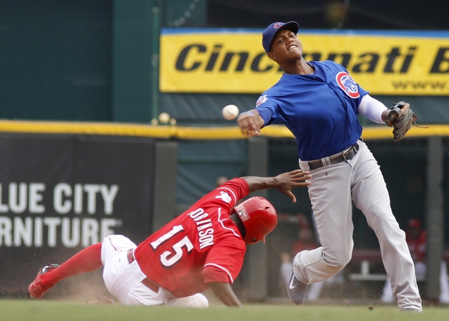 Sep 11, 2013; Cincinnati, OH, USA; Cincinnati Reds left fielder Derrick Robinson (15) is forced out at second base under Chicago Cubs shortstop Starlin Castro (right) in the sixth inning at Great American Ball Park. Mandatory Credit: David Kohl-USA TODAY Sports