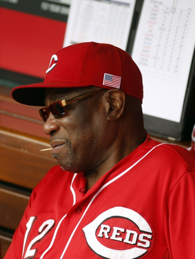 Sep 11, 2013; Cincinnati, OH, USA; Cincinnati Reds manager Dusty Baker sits in the dugout prior to a game against the Chicago Cubs at Great American Ball Park. Mandatory Credit: David Kohl-USA TODAY Sports