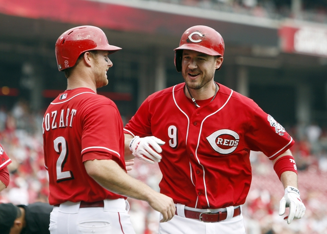Sep 11, 2013; Cincinnati, OH, USA; Cincinnati Reds third baseman Jack Hannahan (9) is congratulated by shortstop Zack Cozart (2) after a three-run home run off Chicago Cubs starting pitcher Jeff Samardzija (not pictured) in the sixth inning at Great American Ball Park. Mandatory Credit: David Kohl-USA TODAY Sports