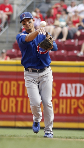 Sep 11, 2013; Cincinnati, OH, USA; Chicago Cubs second baseman Darwin Barney throws to first base during a game against the Cincinnati Reds at Great American Ball Park. Mandatory Credit: David Kohl-USA TODAY Sports