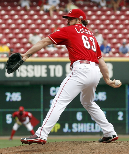 Sep 11, 2013; Cincinnati, OH, USA; Cincinnati Reds relief pitcher Sam LeCure throws against the Chicago Cubs at Great American Ball Park. The Reds won 6-0. Mandatory Credit: David Kohl-USA TODAY Sports
