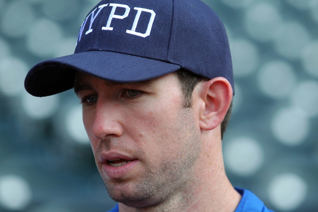 Sep 11, 2013; New York, NY, USA; New York Mets right fielder Mike Baxter (23) wears an NYPD cap in remembrance of 9/11/01 during batting practice before a game against the Washington Nationals at Citi Field. Mandatory Credit: Brad Penner-USA TODAY Sports