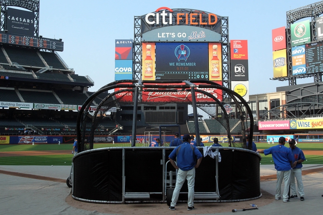 Sep 11, 2013; New York, NY, USA; General view as the New York Mets take batting practice as a sign on the scoreboard remembers 9/11/01 before a game against the Washington Nationals at Citi Field. Mandatory Credit: Brad Penner-USA TODAY Sports