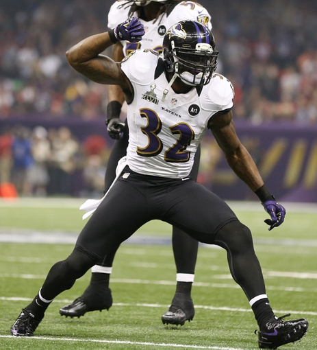 Feb 3, 2013; New Orleans, LA, USA; Baltimore Ravens safety James Ihedigbo (32) celebrates a play against the San Francisco 49ers in Super Bowl XLVII at the Mercedes-Benz Superdome. Mandatory Credit: Mark J. Rebilas-USA TODAY Sports