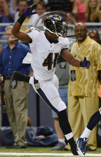 Aug 29, 2013; St. Louis, MO, USA; Baltimore Ravens defensive back Anthony Levine (41) gives chase during the first half at Edward Jones Dome. Mandatory Credit: Jeff Curry-USA TODAY Sports