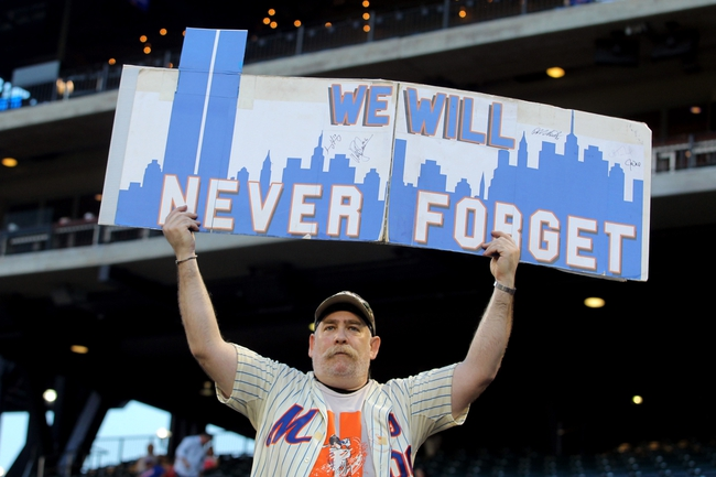 Sep 11, 2013; New York, NY, USA; Sal Candiano of Baldwin, NY holds up a sign before a game between the New York Mets and the Washington Nationals at Citi Field. Mandatory Credit: Brad Penner-USA TODAY Sports
