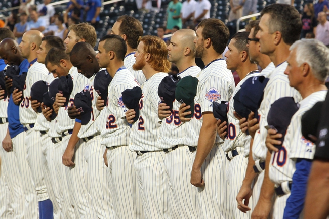 Sep 11, 2013; New York, NY, USA; New York Mets players and coaches stand for the national anthem before a game against the Washington Nationals at Citi Field. Mandatory Credit: Brad Penner-USA TODAY Sports