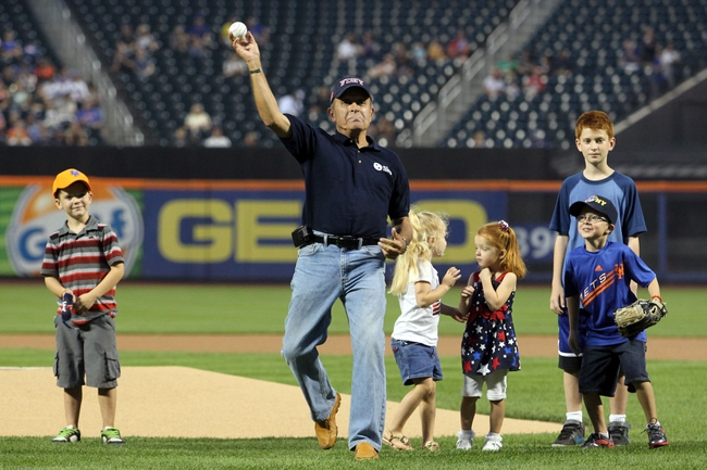 Sep 11, 2013; New York, NY, USA; President of the September 11 Families Association and co-founder of the 9/11 Tribute Center and retired FDNY firefighter Lee Ielpi throws out the ceremonial first pitch before a game between the New York Mets and the Washington Nationals at Citi Field. Ielpi's son Jonathan Ielpi lost his life on September 11, 2001. Mandatory Credit: Brad Penner-USA TODAY Sports