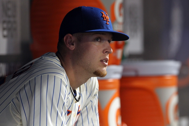 Sep 11, 2013; New York, NY, USA; New York Mets starting pitcher Zack Wheeler (45) watches from the dugout as the Mets bat against the Washington Nationals during the fourth inning of a game at Citi Field. Mandatory Credit: Brad Penner-USA TODAY Sports