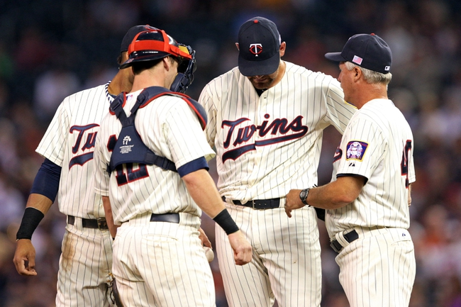 Sep 11, 2013; Minneapolis, MN, USA; Minnesota Twins pitching coach Rick Anderson talks with catcher Chris Herrmann (12) and starting pitcher Mike Pelfrey (37) during the second inning against the Oakland Athletics at Target Field. Mandatory Credit: Jesse Johnson-USA TODAY Sports