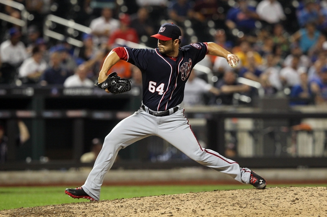 Sep 11, 2013; New York, NY, USA; Washington Nationals relief pitcher Xavier Cedeno (64) pitches against the New York Mets during the seventh inning of a game at Citi Field. Mandatory Credit: Brad Penner-USA TODAY Sports