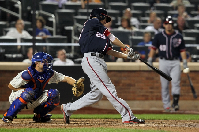 Sep 11, 2013; New York, NY, USA; Washington Nationals first baseman Adam LaRoche (25) hits a single against the New York Mets during the eighth inning of a game at Citi Field. Mandatory Credit: Brad Penner-USA TODAY Sports