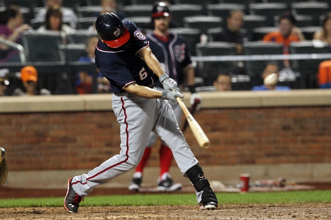 Sep 11, 2013; New York, NY, USA; Washington Nationals second baseman Anthony Rendon (6) hits a two-run double against the New York Mets during the eighth inning of a game at Citi Field. Mandatory Credit: Brad Penner-USA TODAY Sports
