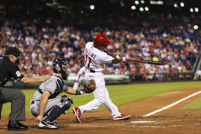 Sep 11, 2013; Philadelphia, PA, USA; Philadelphia Phillies shortstop Jimmy Rollins (11) hits a home run during the sixth inning against the San Diego Padres at Citizens Bank Park. The Phillies defeated the Padres 4-2. Mandatory Credit: Howard Smith-USA TODAY Sports