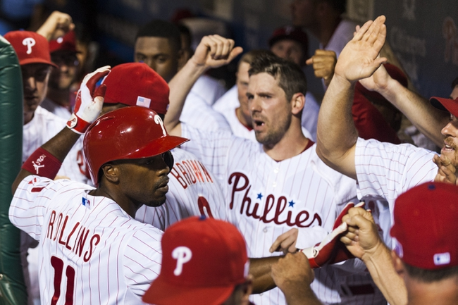 Sep 11, 2013; Philadelphia, PA, USA; Philadelphia Phillies shortstop Jimmy Rollins (11) celebrates hitting a home run during the sixth inning against the San Diego Padres at Citizens Bank Park. The Phillies defeated the Padres 4-2. Mandatory Credit: Howard Smith-USA TODAY Sports