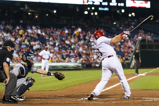 Sep 11, 2013; Philadelphia, PA, USA; Philadelphia Phillies second baseman Freddy Galvis (13) doubles  during the seventh inning against the San Diego Padres at Citizens Bank Park. The Phillies defeated the Padres 4-2. Mandatory Credit: Howard Smith-USA TODAY Sports
