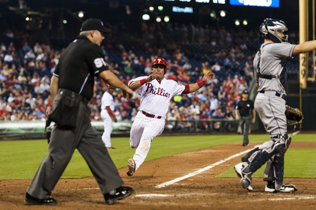 Sep 11, 2013; Philadelphia, PA, USA; Philadelphia Phillies catcher Carlos Ruiz (51) scores during the eighth inning against the San Diego Padres at Citizens Bank Park. The Phillies defeated the Padres 4-2. Mandatory Credit: Howard Smith-USA TODAY Sports