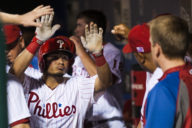 Sep 11, 2013; Philadelphia, PA, USA; Philadelphia Phillies second baseman Freddy Galvis (13) celebrates driving in a run during the eighth inning against the San Diego Padres at Citizens Bank Park. The Phillies defeated the Padres 4-2. Mandatory Credit: Howard Smith-USA TODAY Sports