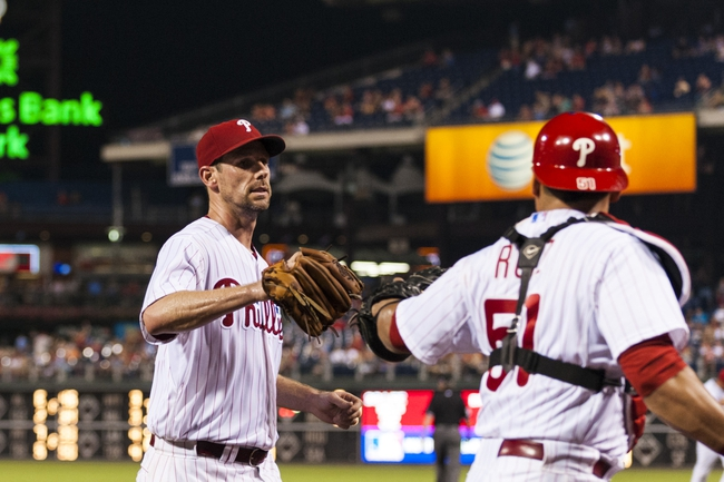 Sep 11, 2013; Philadelphia, PA, USA; Philadelphia Phillies pitcher Cliff Lee (33) celebrates with catcher Carlos Ruiz (51) after pitching the eighth inning against the San Diego Padres at Citizens Bank Park. The Phillies defeated the Padres 4-2. Mandatory Credit: Howard Smith-USA TODAY Sports