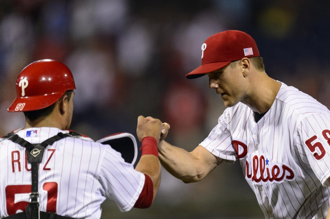 Sep 11, 2013; Philadelphia, PA, USA; Philadelphia Phillies pitcher Jonathan Papelbon (58) celebrates with catcher Carlos Ruiz (51) after pitching the ninth inning against the San Diego Padres at Citizens Bank Park. The Phillies defeated the Padres 4-2. Mandatory Credit: Howard Smith-USA TODAY Sports