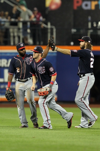 Sep 11, 2013; New York, NY, USA; Washington Nationals center fielder Denard Span (2) and Washington Nationals left fielder Bryce Harper (34) and Washington Nationals right fielder Jayson Werth (28) celebrate a win over the New York Mets following a game at Citi Field. Mandatory Credit: Brad Penner-USA TODAY Sports