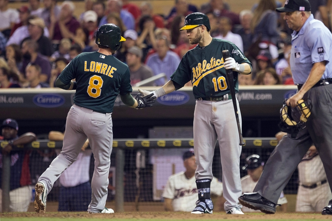 Sep 11, 2013; Minneapolis, MN, USA; Oakland Athletics shortstop Jed Lowrie (8) celebrates with first baseman Daric Barton (10) after scoring a run in the fourth inning against the Minnesota Twins at Target Field. Mandatory Credit: Jesse Johnson-USA TODAY Sports