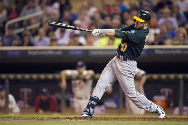 Sep 11, 2013; Minneapolis, MN, USA; Oakland Athletics first baseman Daric Barton (10) hits a single in the fourth inning against the Minnesota Twins at Target Field. Mandatory Credit: Jesse Johnson-USA TODAY Sports