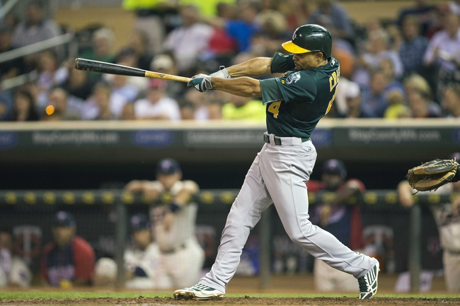 Sep 11, 2013; Minneapolis, MN, USA; Oakland Athletics center fielder Coco Crisp (4) hits a single in the fourth inning against the Minnesota Twins at Target Field. Mandatory Credit: Jesse Johnson-USA TODAY Sports