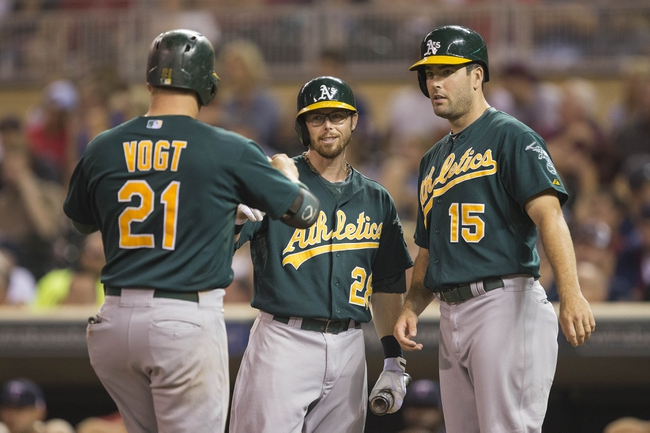 Sep 11, 2013; Minneapolis, MN, USA; Oakland Athletics catcher Stephen Vogt (21) celebrates with second baseman Eric Sogard (28) and designated hitter Seth Smith (15) after hitting a home run in the fourth inning against the Minnesota Twins at Target Field. Mandatory Credit: Jesse Johnson-USA TODAY Sports