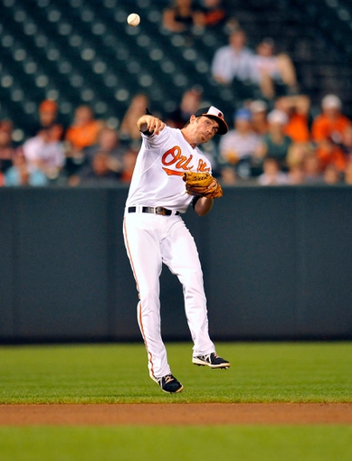 Sep 11, 2013; Baltimore, MD, USA; Baltimore Orioles shortstop J.J. Hardy (2) throws over to first base but cannot get out New York Yankees first baseman Lyle Overbay (not pictured) in the ninth inning at Oriole Park at Camden Yards. The Yankees defeated the Orioles 5-4. Mandatory Credit: Joy R. Absalon-USA TODAY Sports