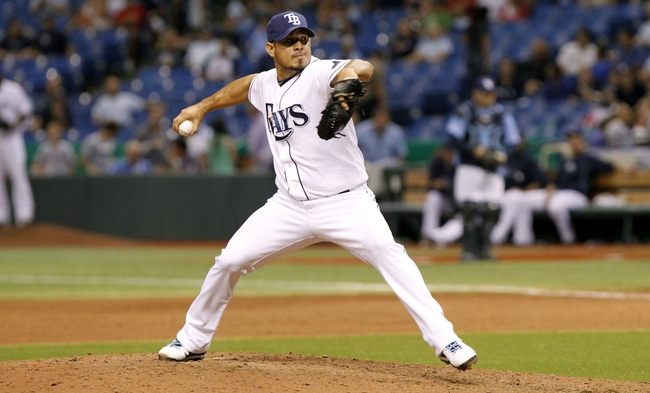 Sep 11, 2013; St. Petersburg, FL, USA; Tampa Bay Rays relief pitcher Joel Peralta (62) throws a pitch during the tenth inning against the Boston Red Sox at Tropicana Field. Boston Red Sox defeated the Tampa Bay Rays 7-3. Mandatory Credit: Kim Klement-USA TODAY Sports