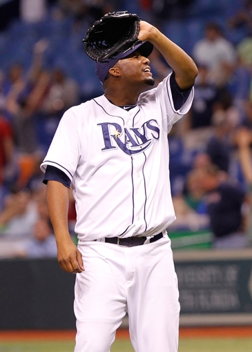 Sep 11, 2013; St. Petersburg, FL, USA; Tampa Bay Rays starting pitcher Roberto Hernandez (40) reacts after giving up a grand slam to Boston Red Sox left fielder Mike Carp (37) (not pictured) during the tenth inning at Tropicana Field. Boston Red Sox defeated the Tampa Bay Rays 7-3. Mandatory Credit: Kim Klement-USA TODAY Sports