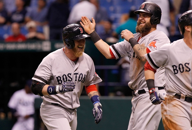 Sep 11, 2013; St. Petersburg, FL, USA; Boston Red Sox left fielder Mike Carp (37) is congratulated by first baseman Mike Napoli (12) after hitting the go-ahead grand slam during the tenth inning against the Tampa Bay Rays at Tropicana Field. Boston Red Sox defeated the Tampa Bay Rays 7-3. Mandatory Credit: Kim Klement-USA TODAY Sports