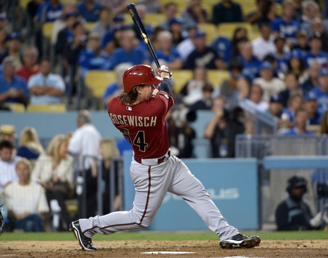 Sep 11, 2013; Los Angeles, CA, USA; Arizona Diamondbacks catcher Tuffy Gosewisch (54) follows through on a run-scoring double in the second inning against the Los Angeles Dodgers at Dodger Stadium. Mandatory Credit: Kirby Lee-USA TODAY Sports