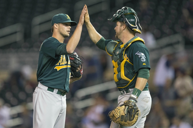 Sep 11, 2013; Minneapolis, MN, USA; Oakland Athletics relief pitcher Evan Scribner (58) celebrates with catcher Stephen Vogt (21) after beating the Minnesota Twins at Target Field. The Athletics won 18-3. Mandatory Credit: Jesse Johnson-USA TODAY Sports