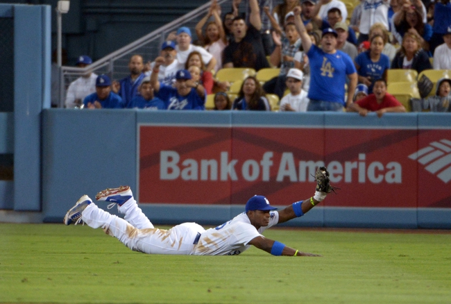 Sep 11, 2013; Los Angeles, CA, USA; Los Angeles Dodgers right fielder Yasiel Puig (66) catches a fly ball by Arizona Diamondbacks shortstop Chris Owiings (not pictured) in the sixth inning at Dodger Stadium. The Diamondbacks defeated the Dodgers 4-1. Mandatory Credit: Kirby Lee-USA TODAY Sports