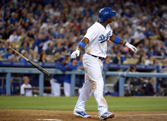 Sep 11, 2013; Los Angeles, CA, USA; Los Angeles Dodgers right fielder Yasiel Puig (66) watches a solo home run in the seventh inning against the Arizona Diamondbacks at Dodger Stadium. The Diamondbacks defeated the Dodgers 4-1. Mandatory Credit: Kirby Lee-USA TODAY Sports