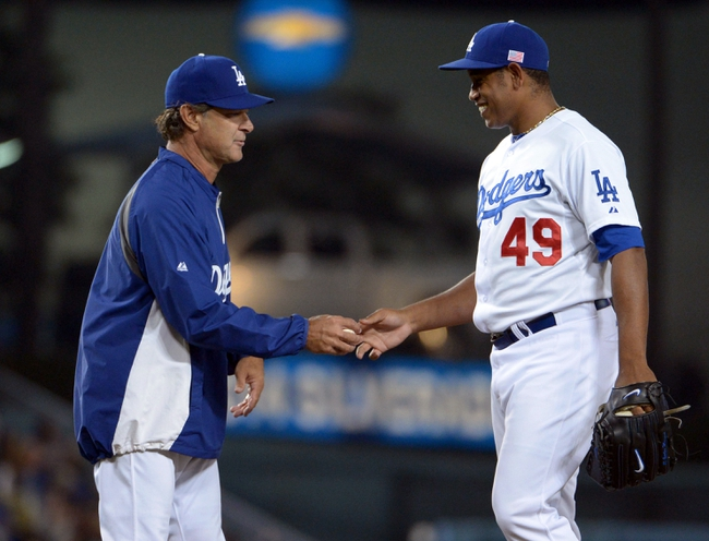 Sep 11, 2013; Los Angeles, CA, USA; Los Angeles Dodgers manager Don Mattiingly (left) removes reliever Carlos Marmol (49) in the seventh inning against the Arizona Diamondbacks at Dodger Stadium. The Diamondbacks defeated the Dodgers 4-1. Mandatory Credit: Kirby Lee-USA TODAY Sports