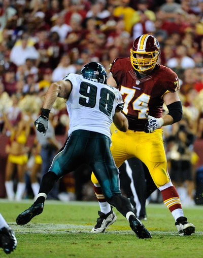 Sep 9, 2013; Landover, MD, USA; Washington Redskins offensive tackle Tyler Polumbus (74) blocks Philadelphia Eagles linebacker Connor Barwin (98) during the second half at FedEX Field. The Eagles won 33 - 27. Mandatory Credit: Brad Mills-USA TODAY Sports