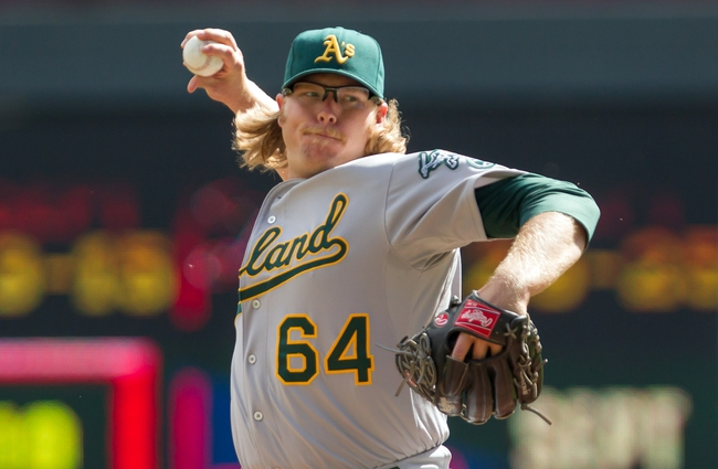 Sep 12, 2013; Minneapolis, MN, USA; Oakland Athletics pitcher A.J. Griffin (64) pitches in the first inning against the the Minnesota Twins at Target Field. Mandatory Credit: Brad Rempel-USA TODAY Sports