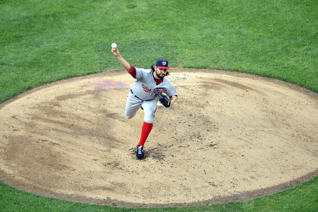 Sep 12, 2013; New York, NY, USA; Washington Nationals starting pitcher Tanner Roark (59) throws a pitch against the New York Mets during the second inning at Citi Field. Mandatory Credit: Joe Camporeale-USA TODAY Sports