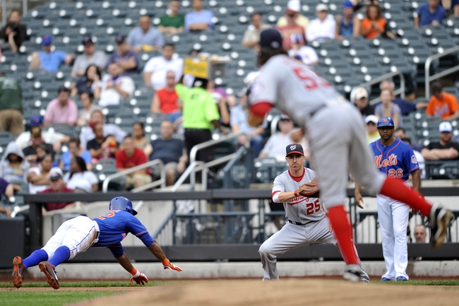 Sep 12, 2013; New York, NY, USA; Washington Nationals starting pitcher Tanner Roark (59) attempts to pick off New York Mets left fielder Eric Young Jr. (22) during the third inning at Citi Field. Mandatory Credit: Joe Camporeale-USA TODAY Sports