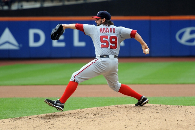 Sep 12, 2013; New York, NY, USA; Washington Nationals starting pitcher Tanner Roark (59) throws a pitch during the fourth inning against the New York Mets  at Citi Field. Mandatory Credit: Joe Camporeale-USA TODAY Sports