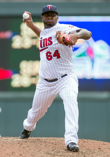 Sep 12, 2013; Minneapolis, MN, USA; Minnesota Twins pitcher Shairon Martis (64) throws a pitch in the seventh inning against the Oakland Athletics at Target Field. Mandatory Credit: Brad Rempel-USA TODAY Sports